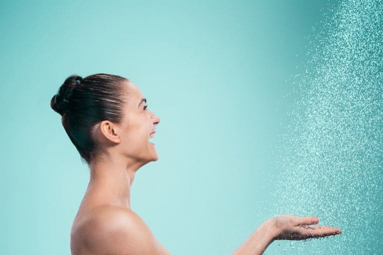 Woman enjoying a hot shower