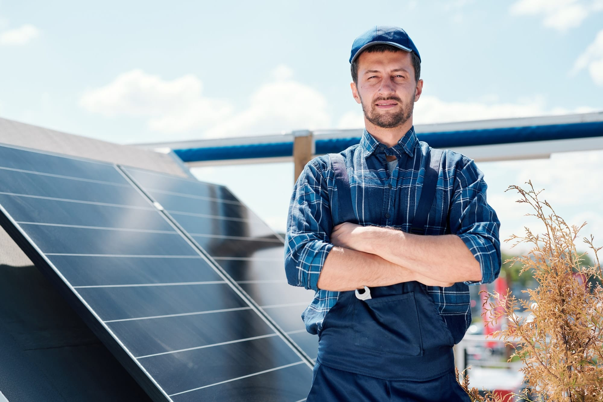 Young successful master of solar panel installation